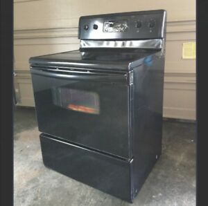 Black glass top Fridgidaire electric stove