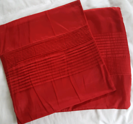 PAIR OF RED CUSHION COVERS