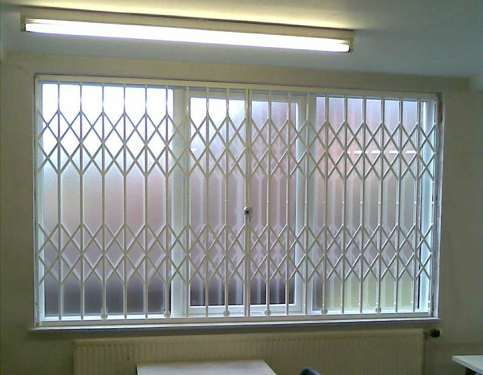 Folding concertina security grilles for home business for Window bars design