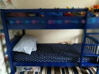 Blue wooden bunk beds