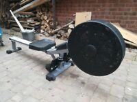 V Fit Rowing Machine, air based with RPM counter and clock etc.