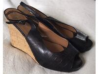 Woman's size 6 peep-toe wedges
