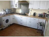 White kitchen units with silver handles