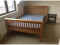 Pine double bed and sprung mattress with all supporting wood present + extra double sprung mattress