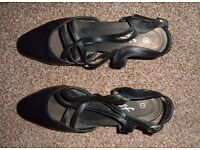 Ladies black sandals with small heal