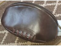 Rugby ball toiletry bag