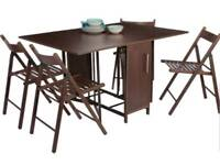 Brand new folding table with 4 chairs