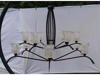 Black chandelier with 12 Murano glass lampshades