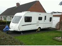 Swift Charisma 5 berth Touring Caravan with Power Touch motor mover
