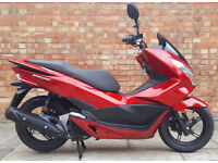 Honda PCX 125 (15 REG) Red, One owner, ONLY 300 miles on the clock!