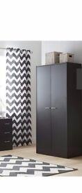 Brand new black oak wardrobe