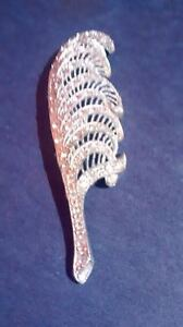 L/N Little Nemo feather brooch with rhinestones.