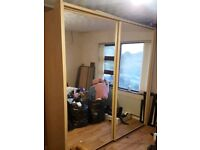 Double mirrored sliding wardrobe