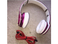 Pink beats headphones