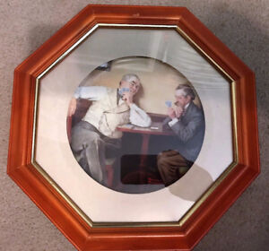 11 Norman Rockwell Plates framed