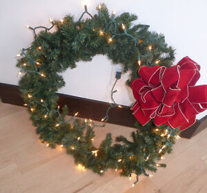 Large wreath with lights $ 15, long garlands with lights $ 20