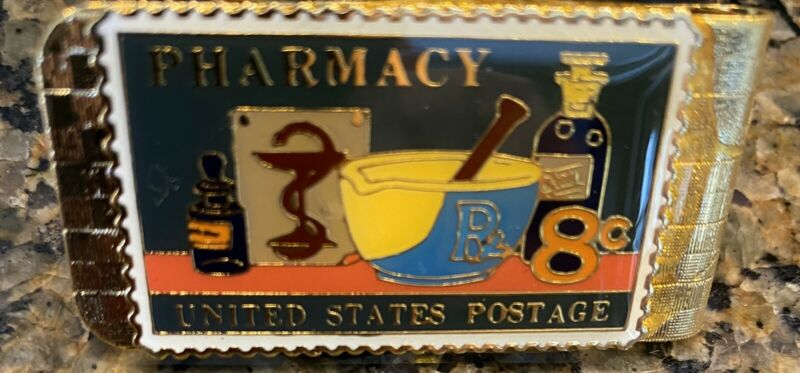 1972 Pharmacy Stamp portrayed on a Brass Colored Money Clip