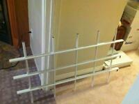 Two Adjustable White security bars for basement windows