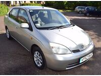 2002 TOYOTA PRIUS HYBRID SILVER. THE BEST EXAMPLE WITH LOWEST MILEAGE AVAILABLE