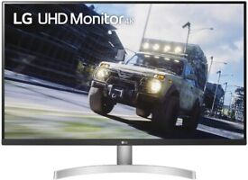 """LG 4k 32"""" monitor and Msi pro 24"""" fhd monitor and to Monitor arms"""