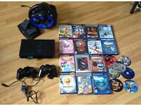 Sony playstation2 console +games+2controllers+driving force joystick steering wheels+memory card