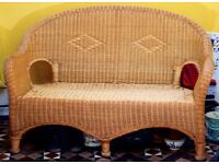Small wicker 2 seater sofa with cushions