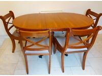 Yew reproduction extendable dining table and four chairs