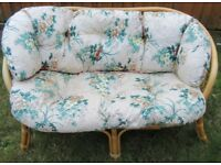 Sofa two seater cane/wicker with floral design cushions