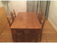 Pine dining table set with four chairs