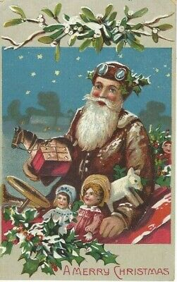 ANTIQUE EMBOSSED CHRISTMAS Postcard  SANTA CLAUS, BURGUNDY SUIT, GOGGLES ON HAT