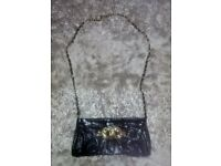 Womans Black Patent Faux Leather Bag with Gold Detail. Primark