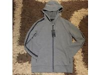 Armani exchange small grey hoodie with writing on sleeve