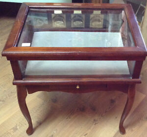 Glass case accent table