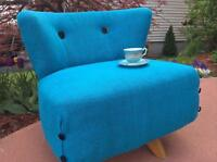 The Delphina mid-century swivel tub chair in azure blue burlap