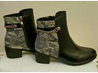 snake patterned with chain low heel ankle boots