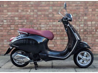 Vespa Primavera 125cc (64 REG) in black, Excellent condition with only 1100 miles!