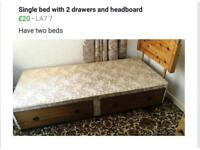 Bed base with two drawers and bed head.