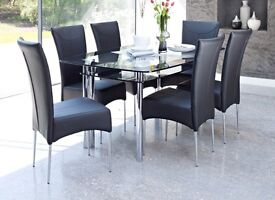 Glass dinning table & 6 black leather chairs.