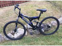 Men's Mountain Bike. Black, great condition, 26 inch wheels, dual suspension, disc brakes, 18 speed.