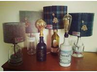 Converted bottle lamps with Handmade Harris Tweed shades