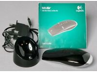 Logitech MX Air Laser Mouse plus Docking/Recharge station and power supply.