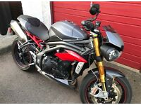 2016 Speed Triple R with loads of extras.