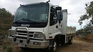 Isuzu FRR 500 Tipbody truck plus Bobcat Skidsteer package Aitkenvale Townsville City Preview