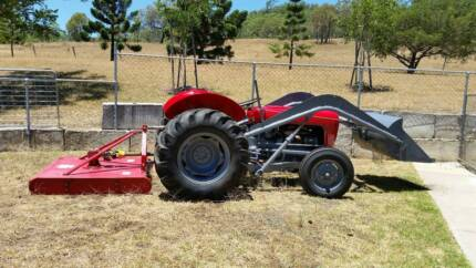 Massey Ferguson tractor with slasher and front end loader.