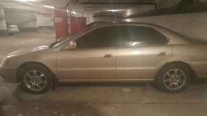 Selling used Acura with set of new winter tires on rims
