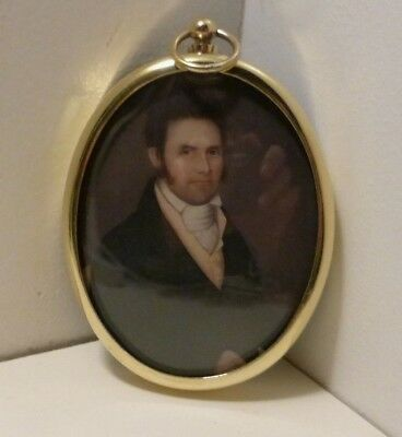 Miniature portrait of gentleman in an oval brass bezel.
