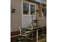 Static caravan or mobile home access steps with platform and railing/handrail, galvanised steel
