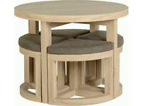 round wooden table and chairs