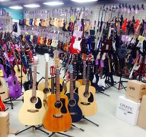 30 different makes of guitars from $99. and up
