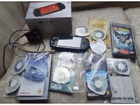 PSP console with 7 games & 2 movies